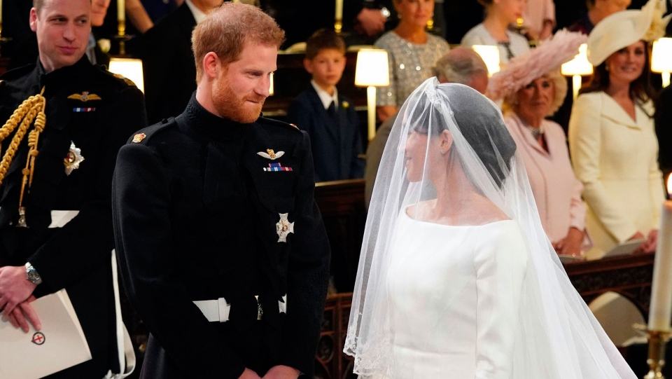 Prince Harry looks at his bride, Meghan Markle, during their wedding ceremony at St. George's Chapel in Windsor Castle in Windsor, near London, England, Saturday, May 19, 2018. (Gareth Fuller / AP)