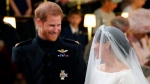 Britain's Prince Harry looks at his bride, Meghan Markle, during their wedding ceremony at St. George's Chapel in Windsor Castle in Windsor, near London, England, Saturday, May 19, 2018. (Gareth Fuller/pool photo via AP)