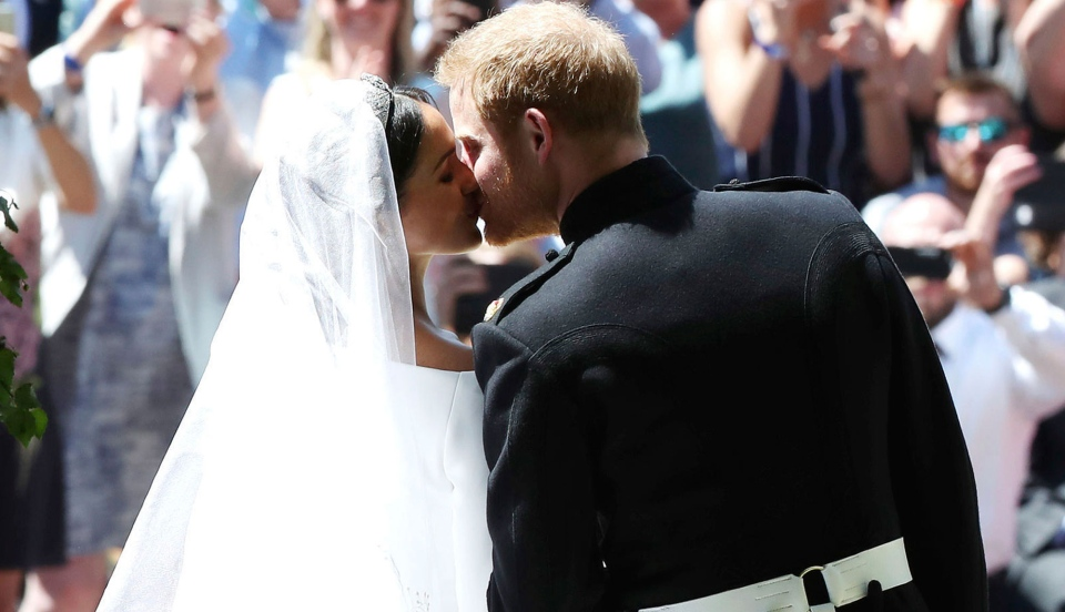 Prince Harry and Meghan Markle kiss on the steps of St George's Chapel after the wedding ceremony in Windsor, near London, England, Saturday, May 19, 2018. (Danny Lawson / AP)