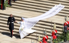 Britain's Prince Harry and Meghan Markle leave after their wedding ceremony at St. George's Chapel in Windsor Castle in Windsor, near London, England, Saturday, May 19, 2018. (Andrew Matthews/pool photo via AP)