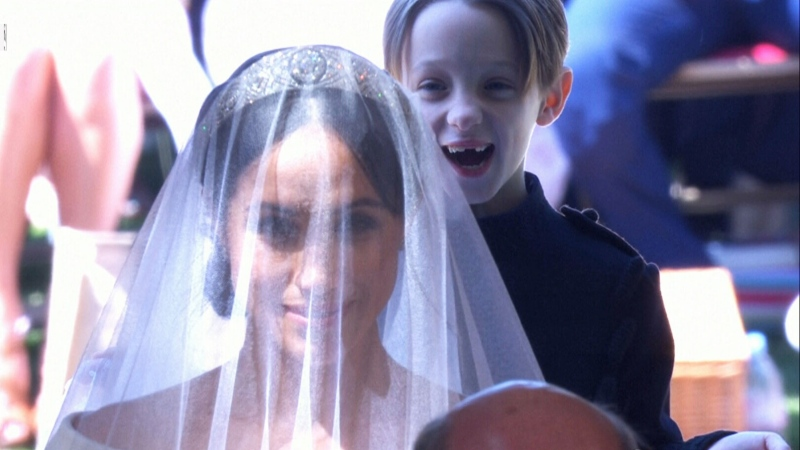 This image of one of the Mulroney twins grinning behind Meghan Markle has gone viral.