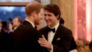 Britain's Prince Harry, left, speaks with Canadian Prime Minister Justin Trudeau during a reception after a receiving line for the Queen's Dinner for the Commonwealth Heads of Government Meeting at Buckingham Palace in London, Thursday, April 19, 2018. (AP Photo/Matt Dunham, Pool)