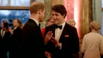 Britain's Prince Harry, left, speaks with Canadian Prime Minister Justin Trudeau during a reception after a receiving line for the Queen's Dinner for the Commonwealth Heads of Government Meeting (CHOGM) at Buckingham Palace in London, Thursday, April 19, 2018. (AP Photo/Matt Dunham, Pool)