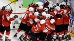 Switzerland's players celebrate after defeating Canada 3-2 at the end of the Ice Hockey World Championships semifinal match between Canada and Switzerland at the Royal arena in Herning, Denmark, Saturday, May 19, 2018. (AP Photo/Petr David Josek)