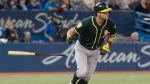 Oakland Athletics' Chad Pinder watches the ball after hitting a grand slam against the Toronto Blue Jays in the eighth inning of their American League MLB baseball game in Toronto on Saturday May 19, 2018. THE CANADIAN PRESS/Fred Thornhill