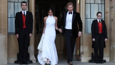 The newly married Duke and Duchess of Sussex, Meghan Markle and Prince Harry, leave Windsor Castle after their wedding in Windsor, England, to attend an evening reception at Frogmore House, hosted by the Prince of Wales, Saturday, May 19, 2018. (Steve Parsons / pool photo via AP)