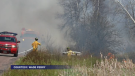 A grass fire shut down a busy section of railway tracks in Moncton.