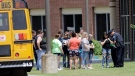 Students are checked before entering Santa Fe High School in Santa Fe, Texas, on Saturday, May 19, 2018. (AP Photo/David J. Phillip)