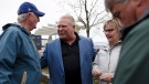 Ontario Progressive Conservative Leader Doug Ford greets people as he tours the Muskoka Craft Beer Festival in Hunstville, Ontario on Saturday, May 19, 2018. (THE CANADIAN PRESS/Cole Burston)