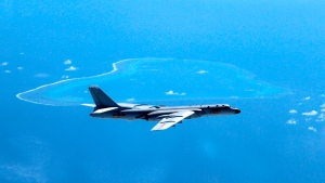 In this undated file photo released by Xinhua News Agency, a Chinese H-6K bomber patrols the islands and reefs in the South China Sea. (Liu Rui/Xinhua via AP, File)