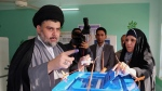 FILE - In this April 30, 2014 file photo, Shiite cleric Muqtada al-Sadr casts his vote at a polling station in the Shiite holy city of Najaf, 100 miles (160 kilometers) south of Baghdad, Iraq. Al-Sadr, the influential maverick Shiite cleric whose political coalition beat out Iran's favored candidates to come in first in national elections, says he wants to form a government that puts Iraqis first.(AP Photo/Jaber al-Helo, File)