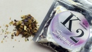 This Feb. 15, 2010, file photo shows a package of K2, a concoction of dried herbs sprayed with a synthetic compound chemically similar to THC, the main ingredient in marijuana. (AP Photo/Kelley McCall)