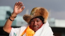 Nepalese veteran Sherpa guide, Kami Rita, 48, waves as he arrives in Kathmandu, Nepal, Sunday, May 20, 2018. (AP Photo/Niranjan Shrestha)