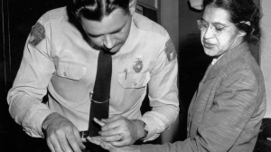FILE - In this Feb. 22, 1956, file photo, Rosa Parks is fingerprinted by police Lt. D.H. Lackey in Montgomery, Ala., after refusing to give up her seat on a bus for a white passenger on Dec. 1, 1955. (AP Photo/Gene Herrick, File)