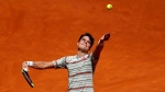 Milos Raonic from Canada serves to countryman Denis Shapovalov a during a Madrid Open tennis tournament match in Madrid, Spain, Thursday, May 10, 2018. Shapovalov won 6-4 and 6-4. (AP Photo/Francisco Seco)