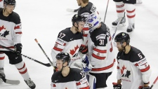 Canada's players react after 1-2 losing to the United States in the Ice Hockey World Championships bronze medal match between Canada and the United States at the Royal arena in Copenhagen, Denmark, Sunday, May 20, 2018. (AP Photo/Petr David Josek)