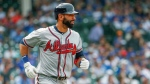 Atlanta Braves' Jose Bautista watches his three-run home run off Chicago Cubs' Jose Quintana during the fifth inning of a baseball game, Monday, May 14, 2018, in Chicago. Braves' Nick Markakis and Tyler Flowers scored on the play. (AP Photo/Kamil Krzaczynski)