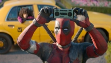 "This image released by Twentieth Century Fox shows Ryan Reynolds in a scene from ""Deadpool 2."" Fox's Deadpool 2 brought in $125 million according to studio estimates Sunday, May 20, 2018, and ended the three-week reign of Disney's ""Avengers: Infinity War ""at the top of the North American box office. (Twentieth Century Fox via AP, File)"