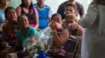 Grieving relatives of passengers who perished in Cuba's worst aviation disaster wait for the identification of the bodies at the morgue in Havana, Cuba, Sunday, May 20, 2018. (AP Photo/Desmond Boylan)