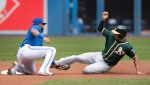 Oakland Athletics' Marcus Semien is caught out stealing second by Toronto Blue Jays' Richard Urena during first inning American League MLB baseball action in Toronto on Sunday, May 20, 2018. THE CANADIAN PRESS/Fred Thornhill