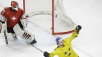 Filip Forsberg celebrates after scoring a game winning goal to Switzerland's goalie Leonardo Genoni during the Ice Hockey World Championships final match between Sweden and Switzerland at the Royal arena in Copenhagen, Denmark on Sunday, May 20, 2018. (AP Photo/Petr David Josek)