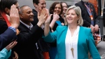 Ontario NDP Leader Andrea Horwath greets local NDP candidates with a high five at a campaign stop in Ottawa on Sunday, May 20, 2018. THE CANADIAN PRESS/ Patrick Doyle