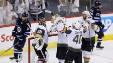 Vegas Golden Knights players congratulate goaltender Marc-Andre Fleury (29) after time the team defeated the Winnipeg Jets during NHL Western Conference Finals, game 5, in Winnipeg, Sunday, May 20, 2018. THE CANADIAN PRESS/Trevor Hagan