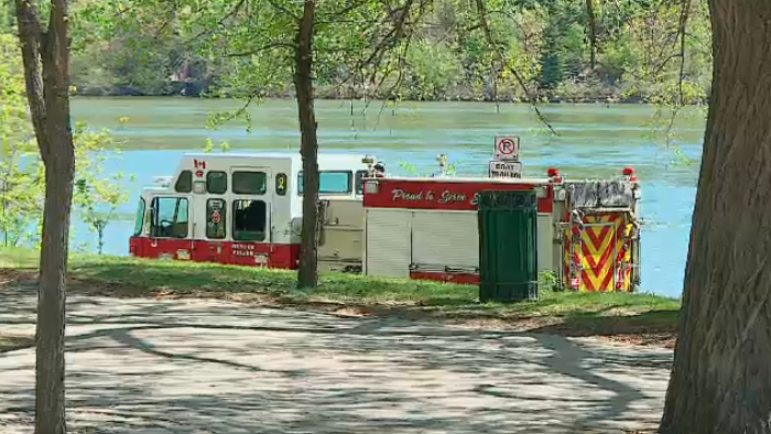 Rescue teams recover a body from South Saskatchewan River, May 20, 2018.