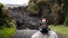 Lava enters the ocean off Highway 137 near Pahoa, Hawaii, Sunday, May 20, 2018. Kilauea volcano, oozing, spewing and exploding on Hawaii's Big Island, has gotten more hazardous in recent days, with rivers of molten rock pouring into the ocean and flying lava causing the first major injury. (AP Photo/Jae C. Hong)