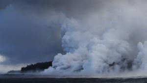 Plumes of steam rise as lava enters the ocean near Pahoa, Hawaii on May 20, 2018. (Jae C. Hong / AP)