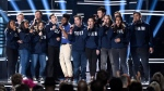 "Khalid, seventh from left, and Shawn Mendes, fifth from right, perform ""Youth"" with the Stoneman Douglas choir, of the Marjory Stoneman Douglas High School, at the Billboard Music Awards at the MGM Grand Garden Arena on Sunday, May 20, 2018, in Las Vegas. (Photo by Chris Pizzello/Invision/AP)"