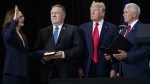 Incoming Central Intelligence Agency director Gina Haspel is sworn in during a ceremony at CIA Headquarters, on May 21, 2018, in Langley, Va. From left, Haspel, Secretary of State Mike Pompeo, President Donald Trump, and Pence. (Evan Vucci / AP)