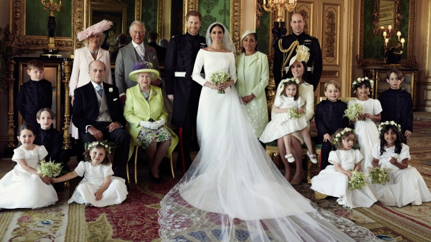 In this photo released by Kensington Palace on Monday May 21, 2018, shows an official wedding photo of Prince Harry and Meghan Markle, center, in Windsor Castle, Windsor, England, Saturday May 19, 2018. Others in photo from left, back row, Jasper Dyer, Camilla, Duchess of Cornwall, Prince Charles, Doria Ragland, Prince William; center row, Brian Mulroney, Prince Philip, Queen Elizabeth II, Kate, Duchess of Cambridge, Princess Charlotte, Prince George, Rylan Litt, John Mulroney; front row, Ivy Mulroney, Florence van Cutsem, Zalie Warren, Remi Litt. (Alexi Lubomirski / Kensington Palace via AP)