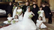 In this photo released by Kensington Palace on Monday May 21, 2018, shows an official wedding photo of Prince Harry and Meghan Markle, center, in Windsor Castle, Windsor, England, Saturday May 19, 2018. Others in photo from left, back row, Brian Mulroney, Remi Litt, Rylan Litt, Jasper Dyer, Prince George, Ivy Mulroney, John Mulroney; front row, Zalie Warren, Princess Charlotte, Florence van Cutsem. (Alexi Lubomirski / Kensington Palace via AP)