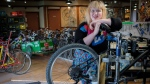 "Good Life Community Bicycle Shop ""greaser"" Hope Madison Fay poses at the shop in Calgary, Alta., Friday, May 18, 2018. One day a week the shop serves only women and trans/non-binary people in an effort to make the bike community more inclusive. THE CANADIAN PRESS/Jeff McIntosh"