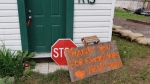 A sign rests outside a home in Grand Forks, B.C. on May 21, 2018.