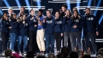 "Khalid, seventh from left, and Shawn Mendes, fifth from right, perform ""Youth"" with the Stoneman Douglas choir, of the Marjory Stoneman Douglas High School, at the Billboard Music Awards at the MGM Grand Garden Arena on Sunday, May 20, 2018, in Las Vegas. (Photo by Chris Pizzello / Invision / AP)"
