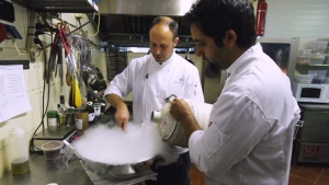 Nadev Malin, left, and JJ Jalil are preparing a dish as part of the Chefs for Peace program.