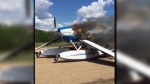 A burning airplane landed at the airport in Cooking Lake on Monday, May 21, 2018. Still taken from video.
