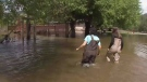 Nervous flood victims try to rebuild