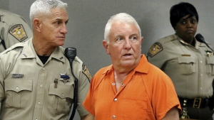Roger Self is escorted into the courtroom during his first appearance hearing at the Gaston County Courthouse, in Gastonia, N.C., Monday, May 21, 2018. (John Clark/The Gaston Gazette)