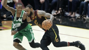 Cleveland Cavaliers' LeBron James drives on Boston Celtics' Terry Rozier in the first half of Game 4 of the NBA basketball Eastern Conference finals in Cleveland on Monday, May 21, 2018. (AP Photo/Tony Dejak)
