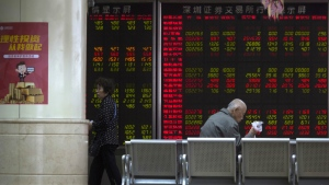 An investor monitors stock prices at a brokerage in Beijing, China, Tuesday, May 22, 2018. (AP Photo/Ng Han Guan)