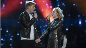 Caleb Lee Hutchinson, left, and Maddie Poppe perform on the season finale American Idol. (Eric McCandless / ABC via AP)