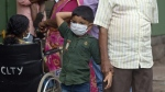 An Indian boys wears a mask as a precautionary measure against the Nipah virus at the Government Medical College hospital in Kozhikode, in the southern Indian state of Kerala, on May 21, 2018. (AP)