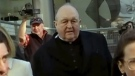 In this image made from video, Archbishop Philip Wilson, centre, heads to Newcastle Local Court, north of Sydney, Australia, on May 22, 2018.  (Australian Broadcasting Corporation via AP)