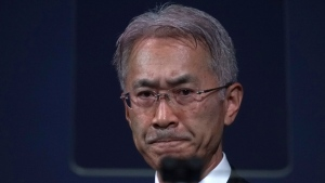 Sony Corp. President Kenichiro Yoshida speaks at a press conference at the company's headquarters Tuesday, May 22, 2018, in Tokyo. (AP Photo/Eugene Hoshiko)