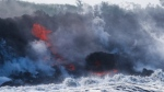 Lava flows into the ocean near Pahoa, Hawaii, Sunday, May 20, 2018. (AP Photo/Jae C. Hong)
