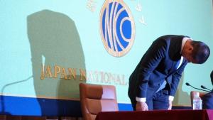 Nihon University's American football player Taisuke Miyagawa bows at a news conference Tuesday, May 22, 2018, in Tokyo. (AP Photo/Eugene Hoshiko)