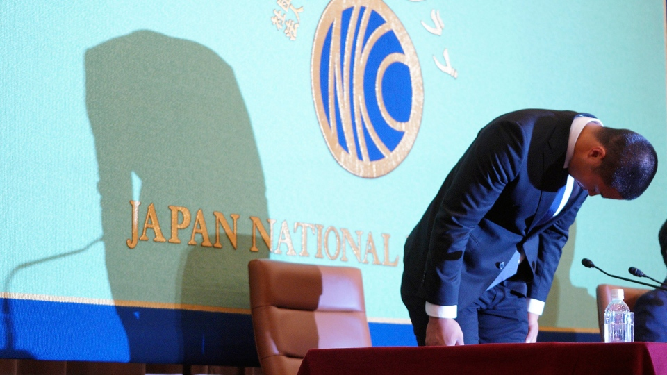 Nihon University's American football player Taisuke Miyagawa bows at a news conference Tuesday, May 22, 2018, in Tokyo. (AP Photo/Eugene Hoshiko)